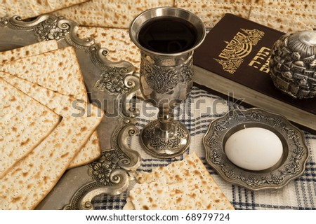 matzot,torah and red wine - stock photo
