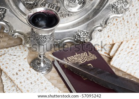 matzot,Torah and silver beaker with feather