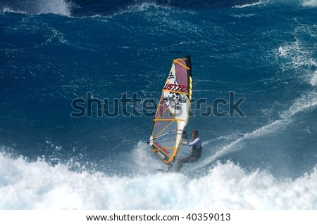 MAUI, HAWAII - NOV. 1: A professional windsurfer competes at the International Ho'okipia Beach Park Expression Session Contest on Nov. 3, 2009 in Maui, Hawaii. The event runs from Nov. 1-16, 2009.