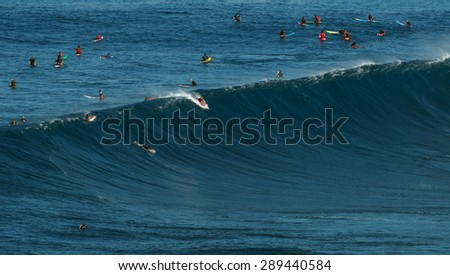 MAUI, HAWAII, USA-DECEMBER 10, 2014: Unknown surfer is riding a big wave at Jaws - stock photo