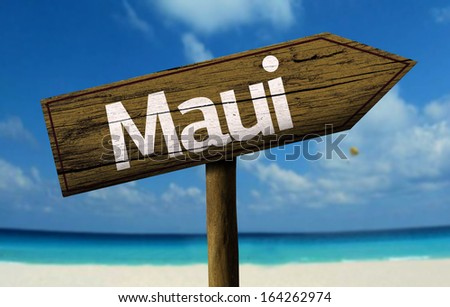 Maui, Hawaii wooden sign with a beach on background  - stock photo
