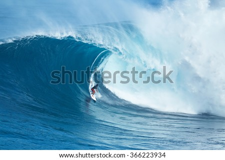 "MAUI, HI - JANUARY 16 2016: Professional surfer Francisco Porcella rides a giant wave at the legendary big wave surf break known as ""Jaws"" on one the largest swells of the year."