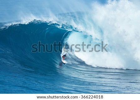 "MAUI, HI - JANUARY 16 2016: Professional surfer Francisco Porcella rides a giant wave at the legendary big wave surf break known as ""Jaws"" on one the largest swells of the year. - stock photo"
