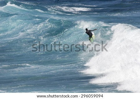 "MAUI, HI - MARCH 09: Professional surfer rides a giant wave at the legendary big wave surf break ""Jaws"" during one the largest swells of the spring March 09, 2015 in Maui, HI."