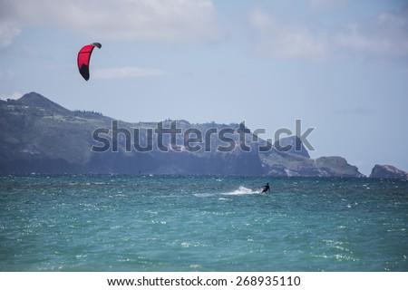 Maui kite surfer from Kanaha Beach Park - stock photo