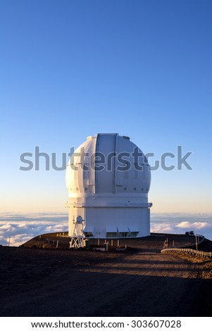 Mauna Kea Observatory on the big island of Hawaii at sunset.  - stock photo