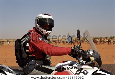 MAURITANIA - JANUARY 6: Rider in the desert during the Budapest - Bamako Rally on January 6, 2006, Mauritania. Riding through the desert is a big fun.