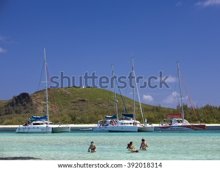 MAURITIUS - APRIL 24: catamarans about Gabrielle's island. Tourists swim in the sea on April 24, 2012 in Mauritius.