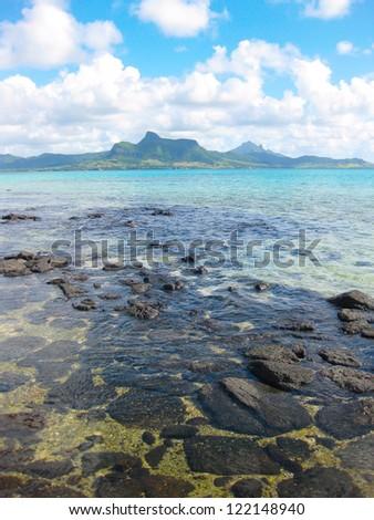 Mauritius coastal view across a bay to the Loin Mountain - stock photo