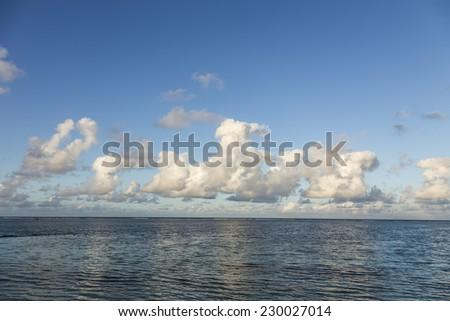 mauritius island sea under a cloudy sky. - stock photo