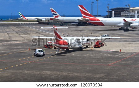 MAURITIUS - NOVEMBER 13: Planes at International Airport on November 13, 2012 in Mauritius. Airport is the base of Air Mauritius, which is flag carrier of the island. - stock photo