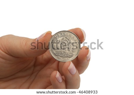 mauritius rupees coin hold by female fingers