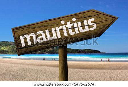 Mauritius wooden sign with a beach on background  - stock photo