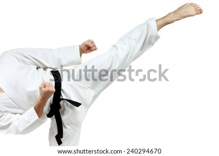 Mawashi geri kick is doing sportsman in a white karategi - stock photo