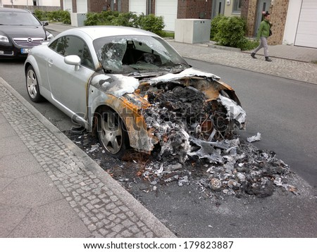 MAY 8, 2013 - BERLIN: a burned out Audi TT sports car in the Friedrichshain district of Berlin - vandalist acts like this have become a common sight in the German capital these days.
