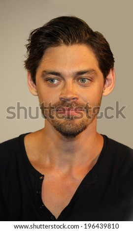"MAY 31, 2014 - BERLIN: actor Tom Payne (isolated background) at a presentation of the DVD of the movie ""The Physician"" (""Der Medicus"") in the Kulturkaufhaus Dussmann, Berlin."