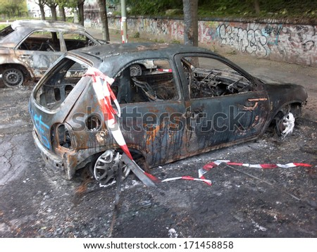 MAY 1, 2011 - BERLIN: burned and vandalized cars which has become a common sight on the streets of Berlin, Berlin-Prenzlauer Berg.