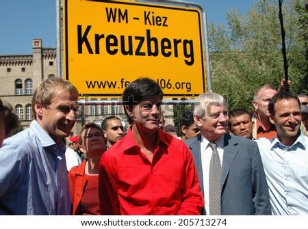"MAY 28, 2005 - BERLIN: Juergen Klinsmann, Joachim Loew, Otto Schily at the presentation of the ""streetfootballworld festival 06"", Berlin-Kreuzberg. - stock photo"