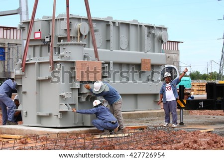 MAY 19, 2016 : CHAIYAPHUM - THAILAND : Under the control of engineers to transport equipment or transformers Shunt Reactor using large cranes at high voltage power station