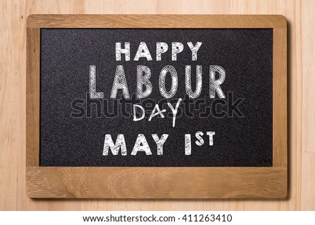 May Day, May 1. Small chalk board with text Labor Day. International Workers' Day