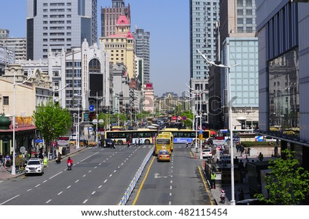 May 4, 2016.  Harbin, China.  Cars and buses moving down one of the busy streets within the city of harbin located in Heilongjiang province China.