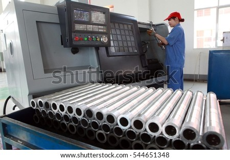 May 11, 52012, Jiangxi, Mount Lu, Jiujiang, a fire equipment production workshop, a woman is operating CNC machine tools.