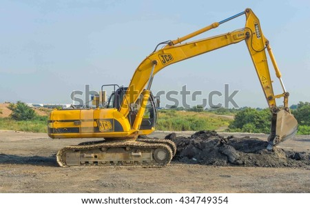 May 14, 2016 - Kuala Lumpur, Malaysia : A close-up of yellow excavator on a construction site against blue sky.