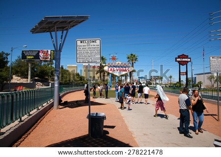 May 15, 2015 Las Vegas, Nevada.  People from around the world congregate around the World Famous Las Vegas Sign for Photo Ops as they enter Las Vegas on Vacation and for Conventions.  - stock photo
