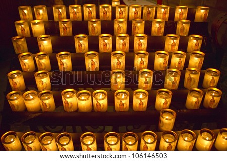 MAY 2004 - Lit Candles inside the Notre Dame Cathedral, Paris, France