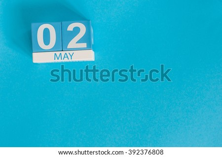 May 2nd. Image of may 2 wooden color calendar on blue background.  Spring day, empty space for text.  last spring month - stock photo
