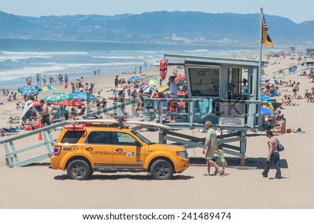 MAY 22ND, 2011- MANHATTAN BEACH, CA:Lifeguard tower overseeing beachgoers in Manhatttan Beach, California. - stock photo