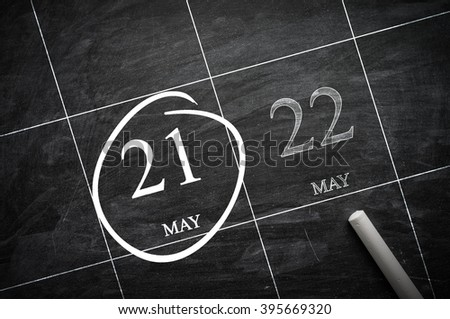 May 21 on a blackboard calendar to remind you an important appointment. - stock photo