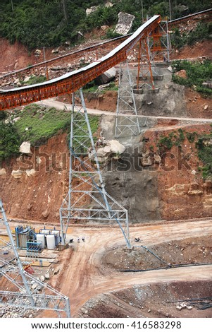 MAY 04, 2016 : PAKXAN - LAO PDR : Under-construction of concrete dam with heavy equipment and cement conveyor structure and site landscape of Namngiep project in Pakxan District, LAO PDR.
