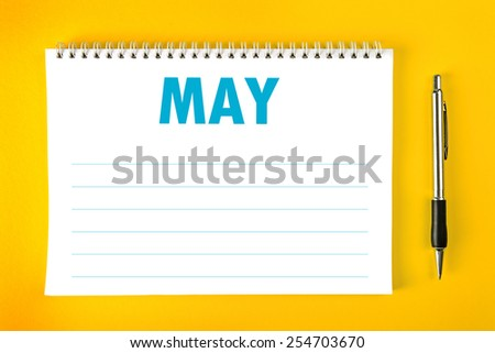 May Paper Calendar Blank Page with Spiral Binding as Time Management and Schedule Concept, top view - stock photo