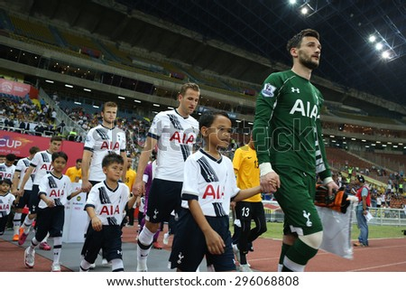May 27, 2015 - Shah Alam, Malaysia: Tottenham Hotspur's captain Hugo Lloris (green jersey) leads his team out into the field. Tottenham Hotspur is on a Asia-Australia tour. - stock photo