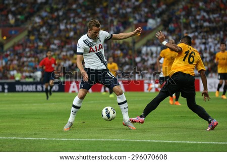 May 27, 2015- Shah Alam, Malaysia: Tottenham Hotspur's striker Harry Kane (18) dribbles the ball in the friendly match against the Malaysian Team. Tottenham Hotspur is on a Asia-Australia tour. - stock photo