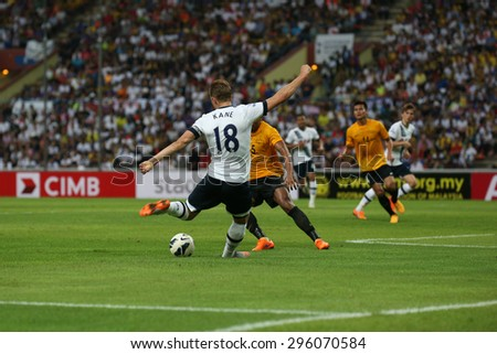 May 27, 2015- Shah Alam, Malaysia: Tottenham Hotspur's striker Harry Kane (18) kicks the ball in the friendly match against the Malaysian Selection Team. Tottenham Hotspur is on a Asia-Australia tour. - stock photo