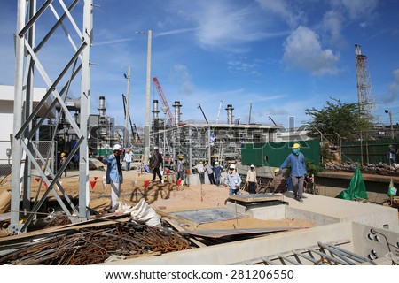 MAY 22, 2015: SRIRACHA, THAILAND. View of new construction of electrical power switchgear with concrete work and equipment installation on bright blue sky and a sunny day.