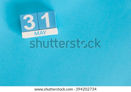 May 31st. Image of may 31 wooden color calendar on blue background.  Last spring day, Spring end. Empty space for text. World blondes Day - stock photo