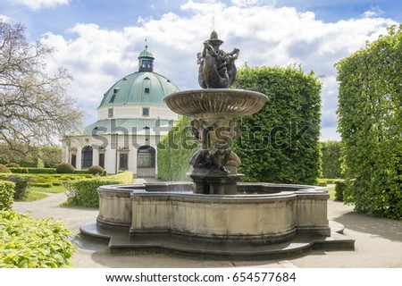May 10, 2017, Sunny day in Flower gardens in french style, fountain and rotunda building in Kromeriz, Czech republic, Europe