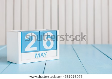 May 26th. Image of may 26 wooden color calendar on white background.  Spring day, empty space for text