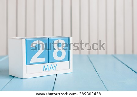 May 28th. Image of may 28 wooden color calendar on white background.  Spring day, empty space for text