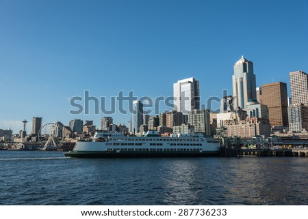 MAY 15th 2015, Seattle: A ferry parking in front of the bay near Seattle downtown, business district. Seattle, WA, USA