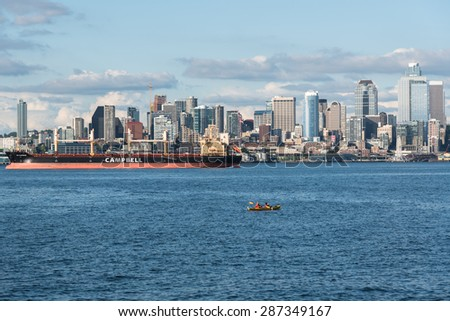 MAY 15th 2015, SEATTLE: A view of Seattle downtown, skyscraper, business district and blue ocean from Alki Beach, Seattle WA