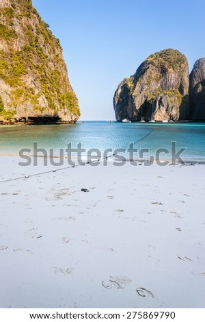 Maya Bay is  sheltered by  high cliffs on three sides with several beaches with soft white sand and exotic fish in clear water - stock photo