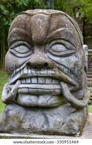 Maya headstone statue - stock photo