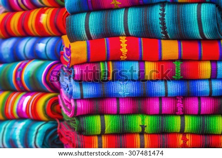 Mayan blankets textile designs on the market in Chichicastenango in Guatemala - stock photo