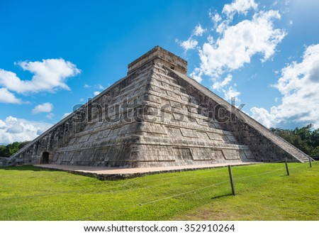 Mayan Chichen Itza pyramid side view in the sun in Mexico - stock photo