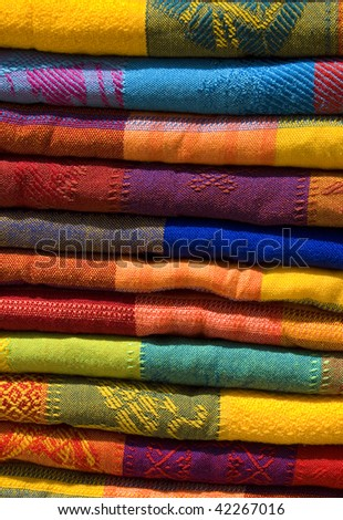Mayan colorful blankets for sale at an outdoor market in chiapas, mexico - stock photo