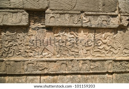 Mayan figures carved into wall at Chichen Itza in Mexico